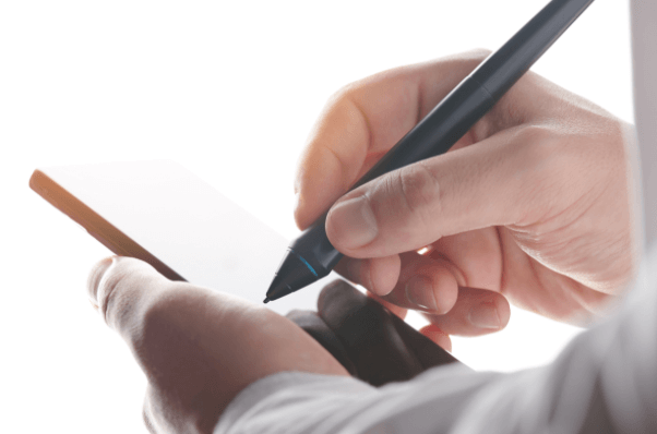 person signing a document on their phone